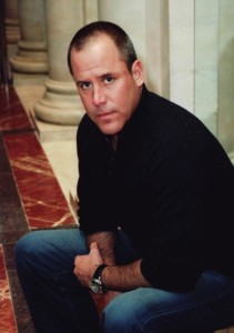 Vince-Flynn-seated-at-pillars
